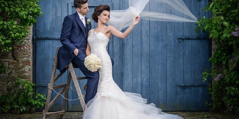 bride and groom with flowing veiil