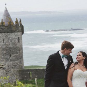 married couple with tower and sea