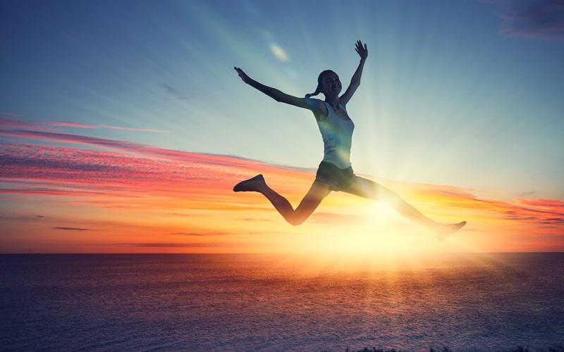 sunset woman jumping