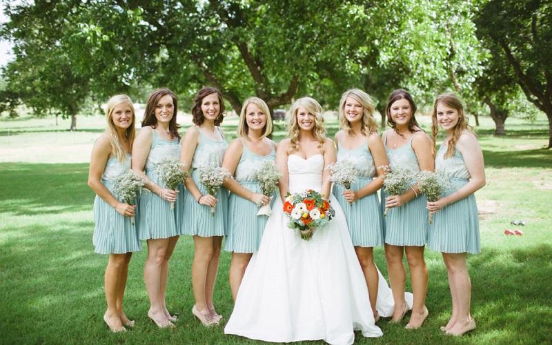 bride and bridesmaids in short dresses