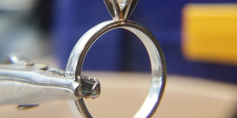 Man studies jewellery design to propose with a handmade engagement ring