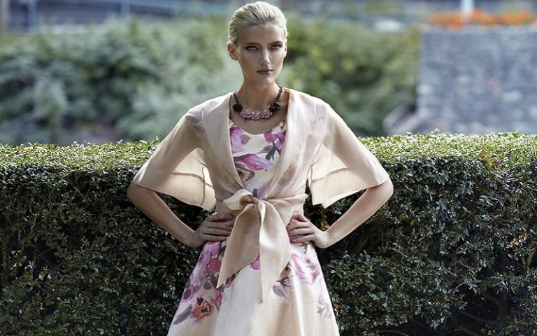 lady in pink dress with wrap