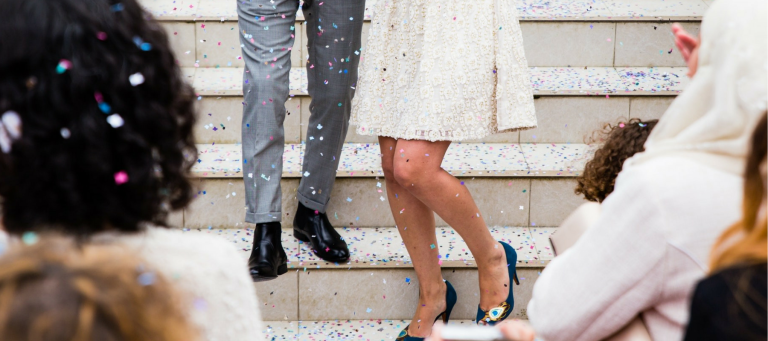 bride and groom on steps