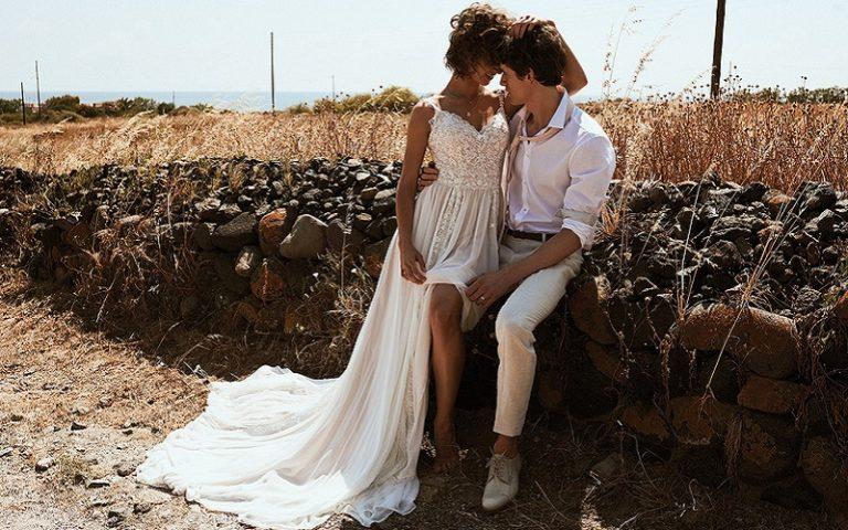 boho bride and groom embracing
